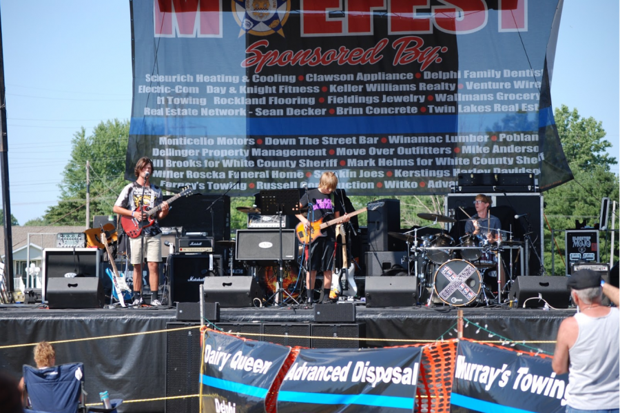Burning Grove performing on stage in front of a live audience for the first time. They performed at Moefest on August 3, 2019, at Pine View Golf Course in Monticello, IN. Jalen Shidler on the guitar and vocals, Avery Shidler on the bass, and Brandt Minnicus on the drums.