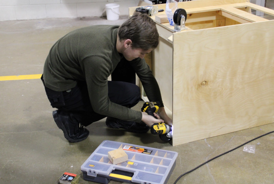 """Arcade Construction Steve Hinz, at the robotics shop on Tuesday. Steve Hinz, Build Captain, is working on the arcade project. When asked how long will it take to build the robot this season, he said,"""" It will take us all of build season."""""""