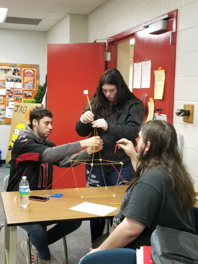 Hunter Coble, Christa Marvin, and Anthony Rivera participate in team building activities during JAG class.