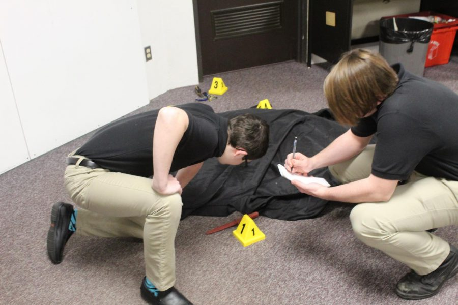 Students in Criminal Investigations conduct a crime scene investigation.