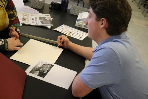 Mrs. Padlo helping Colton Thorpe with his stunning Belair Belair drawing before he starts painting.