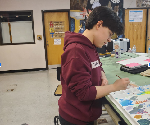 Twin Lakes artist, Sam Hitz, is shown painting in one of their art classes.