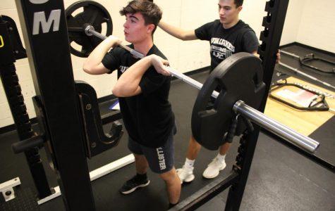 Ryan Denton prepares to squat 135.