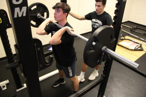 Ryan Denton prepares to squat 135.