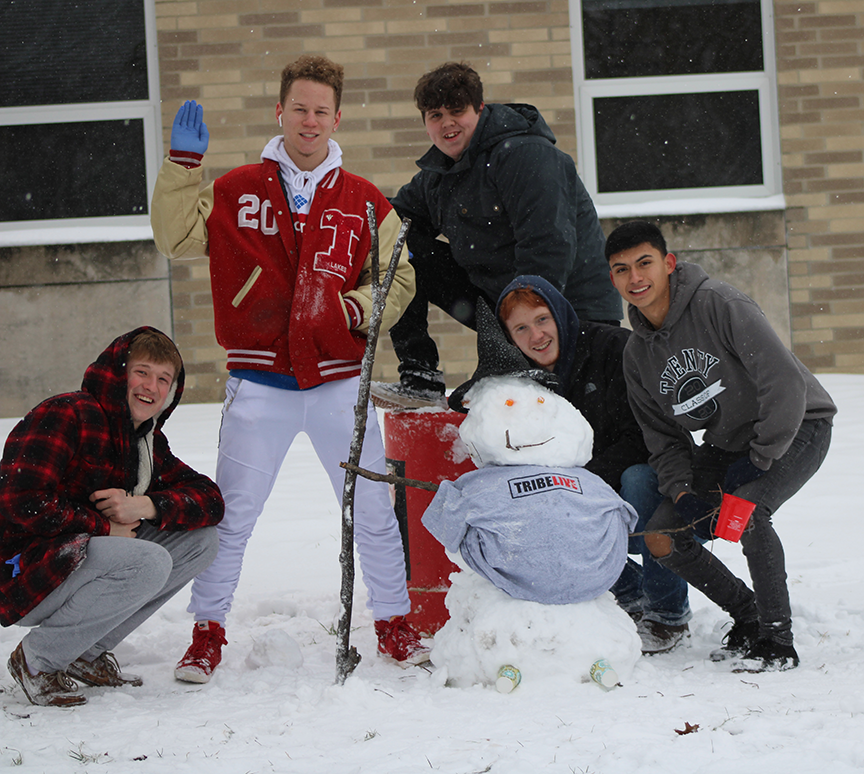Jacob Milligan, Dre Bottoms, Alex Lane, Harley Criswell and Anthony Ocampo built a snowman in front of the high school today.