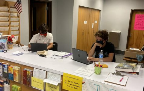 Teachers' Assistants Working Hard in the Counselors Office.