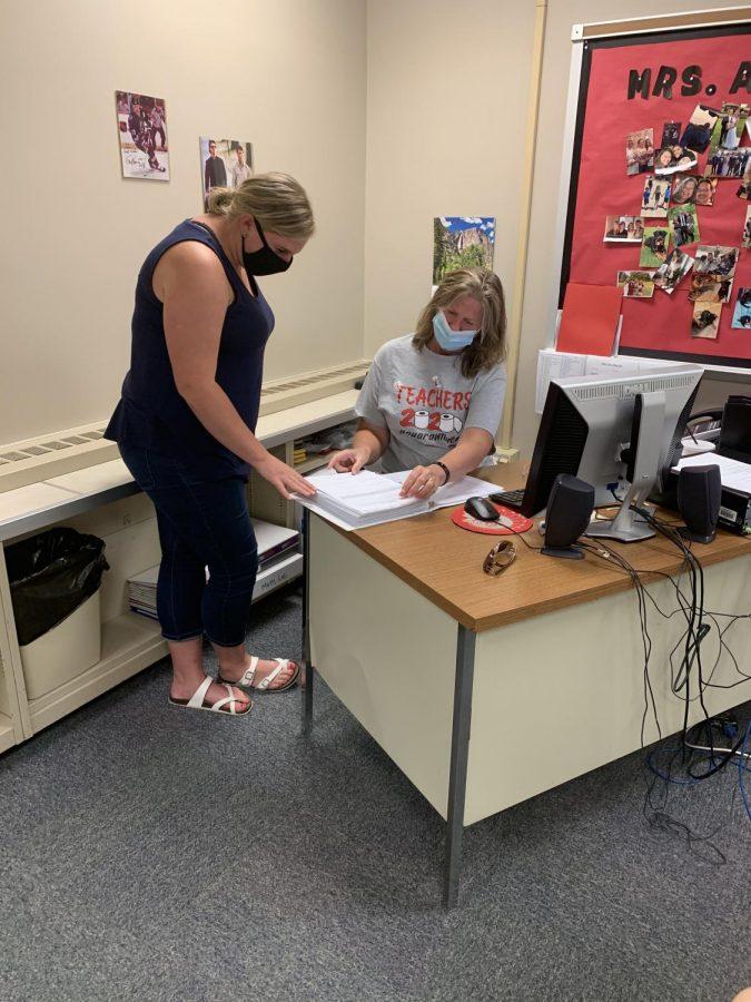 Mrs. McClatchey and Mrs. Allen discuss procedures.