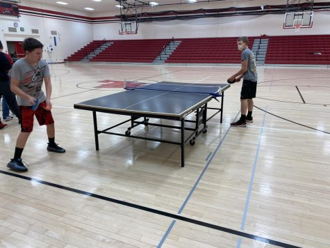 Ryan Emmons and Aidan Pruitt play an intense game of ping pong.