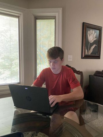 """Back Home Again"" Junior Ethan Bowsman works on his E-Learning for the first time in the new school year. After news broke of a 10 day absence from school, students will continue their education online. This is not brand new to students as this is their second quarantine of 2020."