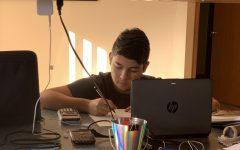 Here Senior Salvador de Leon is working on his Pre-Calculus assignments.