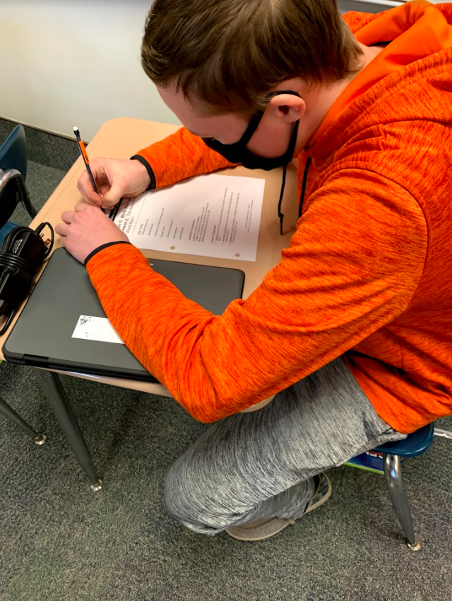 Jimmy Hunt is shown working on his Spanish homework. Hunt has been working hard to get all his Spanish homework done. He is currently working on vocabulary.
