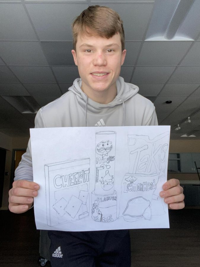 """Ethan posses with his art picture. """"Art really calms me down after a stressful day."""" Art classes are offer students to show off their creative abilities."""