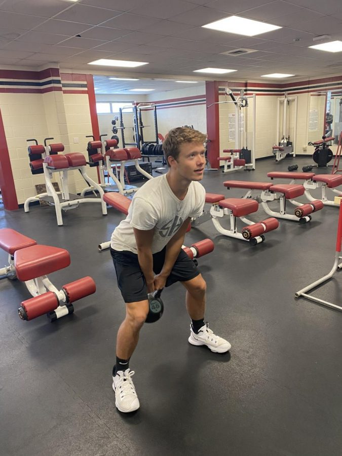 Gage Businger (12) puts in that work in his APC class.