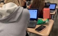 Jillian Bowman (10) focuses during a class discussion.