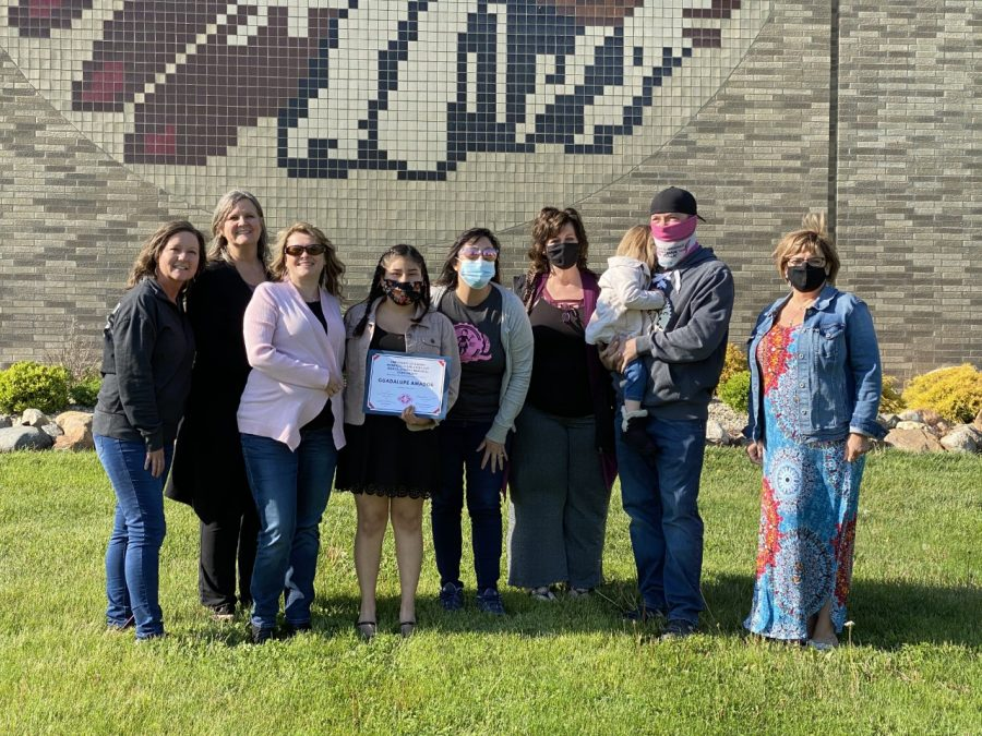 Lupe, Jess's mom (Kim O'Neal), Jess's husband (Carey Stevens, TL Class of 2004), and their daughter (Aurora, 3yrs) are shown together; along with GPO members Lisa Minier, Kathy Saker, Monica Gainor, Peggy Hofmeyer, and Laurie Webster.