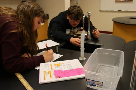 """Vivian Cormican and Andrew Holst are seen participating in a lab in ICP. ICP stands for Integrated Chemistry and Physics. The lab that they are performing is a metric measurement lab. Vivian said, """"We learned how to use a scale, it was really sensitive."""" Andrew said, """"Life is short, take ICP!"""" ICP is taught by Mr. Massura."""
