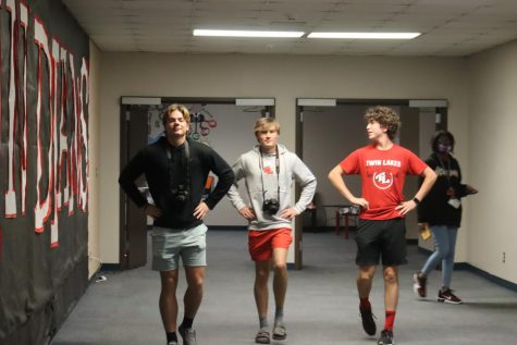 Cooper Pell, Hayden Hubbard and Luke Deno march to take photo