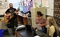 Mrs. Wheeler frequently uses her guitar in class. Students look forward to days she plays it and say it helps them engage in the class.
